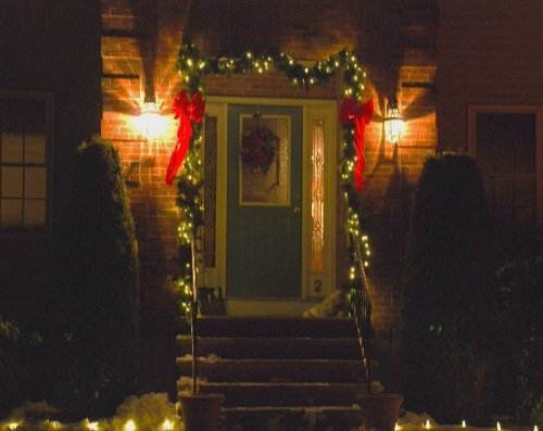 Front Door Highlighted with Christmas Lights and Garland